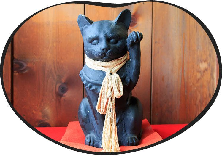 黒い招き猫の画像